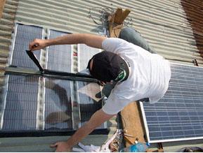 Installing solar panels in Rwanda