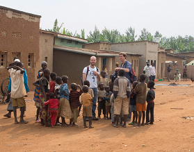 Chris and Davide surrounded by kids living in the village of Kagano, Eastern province of Rwnada (Photo taken by Phillip Wood).