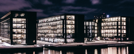 Office buildings at night with the lights on