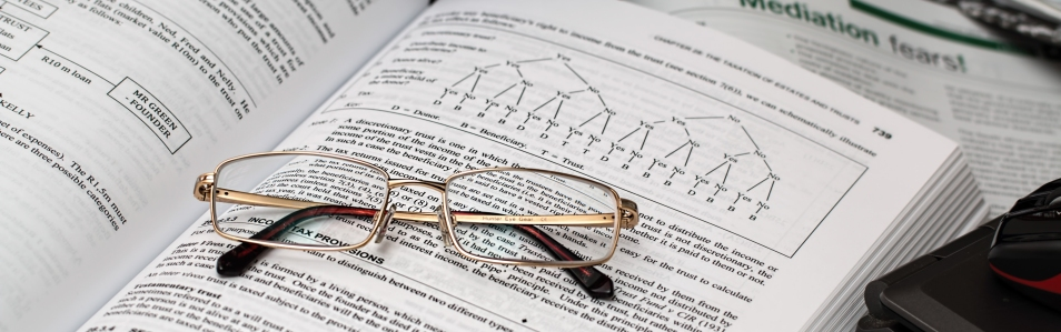 Pair of glasses sitting on an open book