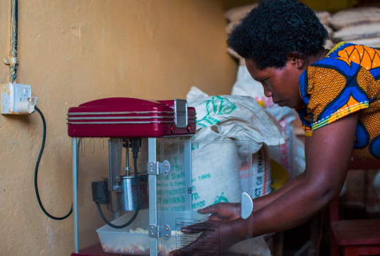 Example of productive use of energy facilitated by MeshPower and E4I, a popcorn making machine that increases the income from the shop. Photo from Meshpower